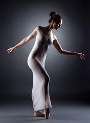 Image of pretty skinny ballerina posing in studio