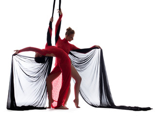 Sexy young dancers posing with silk ropes