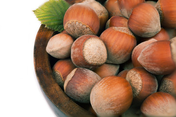 Hazelnuts in a wooden plate.