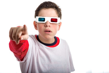 Soft skinned Boy wearing 3D googles points astonished
