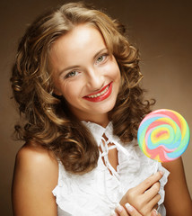 Young woman with colorful lollipop
