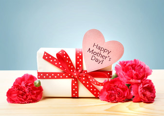 Mothers day message with gift box and carnation flowers