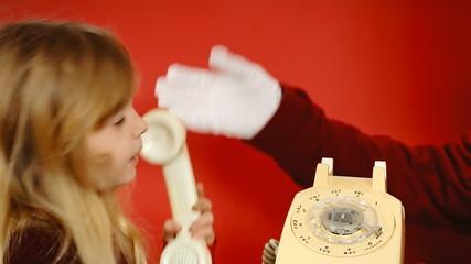 Little girl vintage telephone butler talking