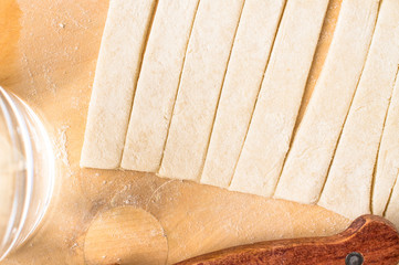 Strips of dough on a cutting board