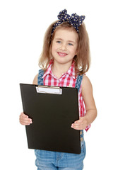 Smiling little girl holds up a folder with papers.