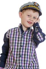 smiling little boy in a sea cap
