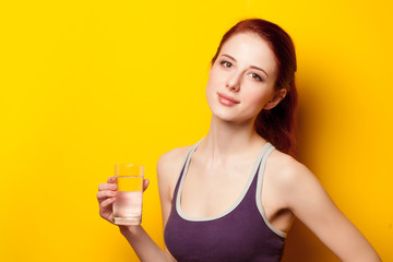 Woman with water glass after
