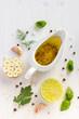 ingrediets for salad dressing. Olive oil, garlic, lemon, herbs a - 80996284
