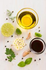 ingrediets for salad dressing. Olive oil, garlic, balsamic vineg