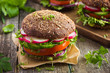 Healthy fast food. Vegan rye burger with fresh vegetables - 80996477