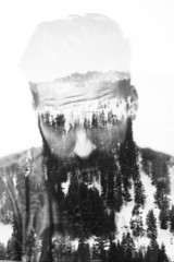 Double exposure of bearded guy and winter landscape