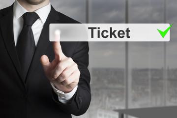 businessman pushing button ticket