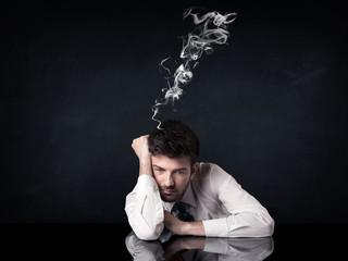 Depressed businessman with smoking head