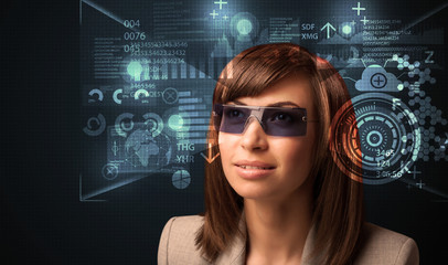 Young woman looking with futuristic smart high tech glasses