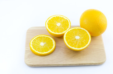 Pieces of Orange on a cutting wooden board