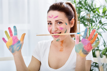 Woman with colorful hand