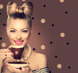 Retro styled model girl drinking coffee or tea