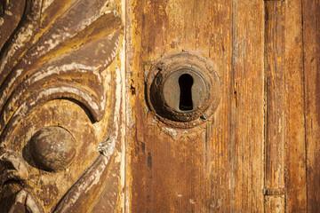Key lock in the wooden door.
