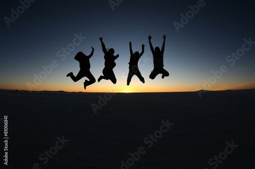 Happy friends jumping outdoor - 81006841