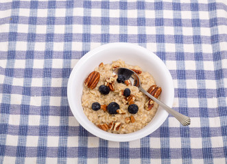 Bowl of Oatmeal with Fresh Blueberries and Chopped Pecans