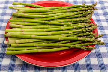 Fres Raw Asparagus on Red Plate