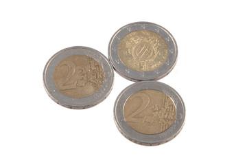 Euro coins on a plain white background.