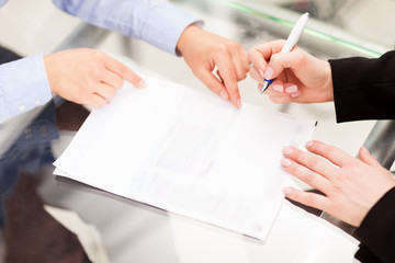 Business partner are signing the contract