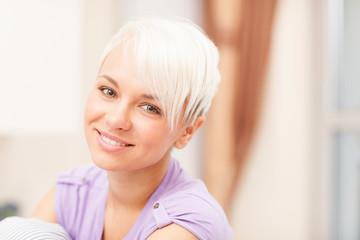 Portrait of a blonde woman with violet t-shirt