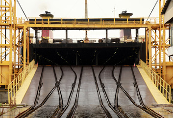 Big industrial Ro-Ro ship is loading. Railway ramp