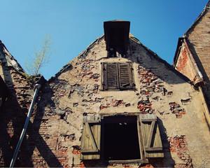 Abandoned old house near City Centre, Riga. Retro filter photo.