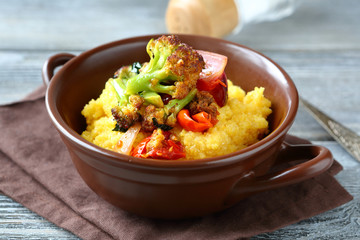 Polenta with roasted peppers, tomatoes and broccoli