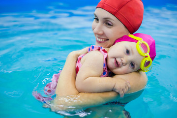 baby with mother in pool