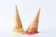 yellow passion fruit and red strawberry ice cream cones dropped - 81019226