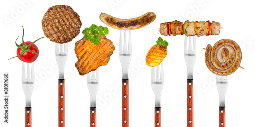 grilled meat on forks - 81019660
