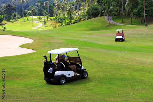 Papiers peints Golf Golf cars on the golf course