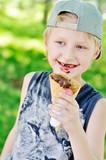 cute little boy eating tasty ice-cream