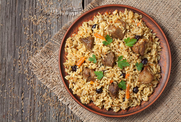 Arabic national rice food called pilaf cooked with fried meat