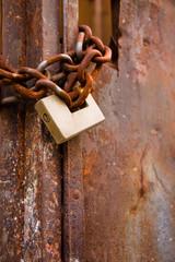 Metal gate closed with padlock