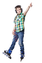 Full length portrait a boy on rollers pointing up sign isolated
