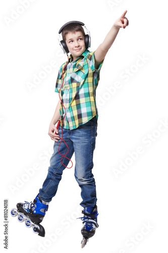 Full length portrait a boy on rollers pointing up sign isolated - 81024018