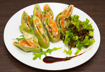 Pancakes from spinach with a fresh-salted salmon