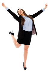 Successful businesswoman jumping for joy