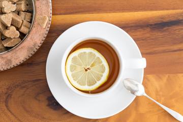 Cup of herbal tea with brown sugar