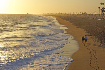 Couple walking on the California Beach at Sunset