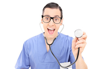 Cheerful young doctor in blue uniform holding a stethoscope and