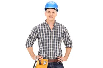 Confident construction guy in uniform wearing helmet and posing