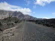 Paved road through black lava field