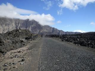 Paved road through black lava field