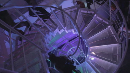 Guests entering, leaving nightclub, movement on stairs