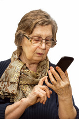 Pensioner woman with two pair of glasses dealing cell phone
